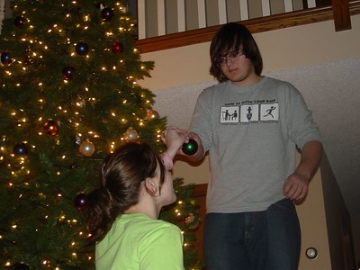 Sam H. serves Zack as he decorates