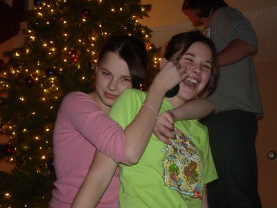 Liz (modeling the ornament) and Samantha (being strangled by the model)