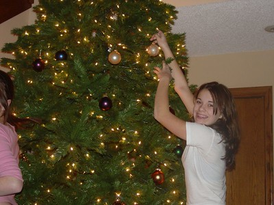 Nicky adds an ornament to our new tree on our first Christmas as a family!