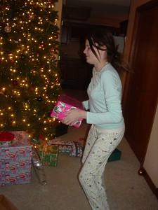Liz passes out presents.