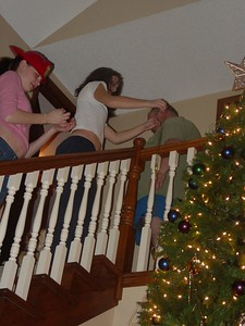 Nicky and Liz (the firefighter) add decorative tinsel.