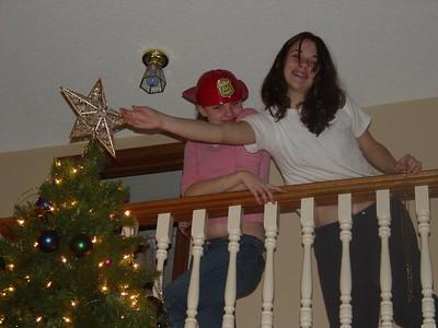 Nicky strokes the star lovingly while Liz strikes a pose.