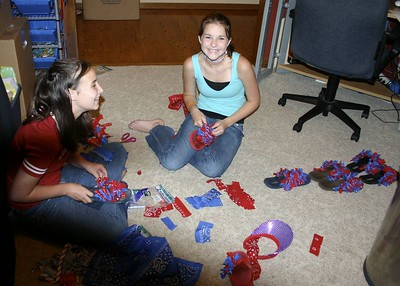 Liz's shoe sweatshop....Liz forces the Sammy's to work in sub-human conditions making special bandana flip-flops for the rodeo.  They try to be brave and act like they are having fun as they endure these brutal conditions.