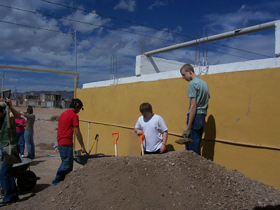 Our team, of 10 people, moved all of that dirt out into the clearing (upper left hand corner) mixed it with cement and water and made the area from the yellow wall the wheelbarrow on the left paved. It was incredibly hard, but actually a blast. From left to right the three boys are Kevin (Peru) Ellstrand, Spencer Rogers, and Adrian Beriese, which I probably just spelled wrong.