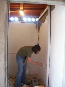 Our other leader Lindsay Lewis, working on one of the three rooms our team painted. All white. If I never see another white paint bucket it will be too soon.