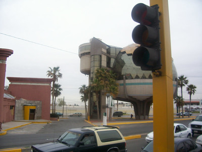 Just across the border, right inside of Mexcio, a veiw from the bus. Cool building.
