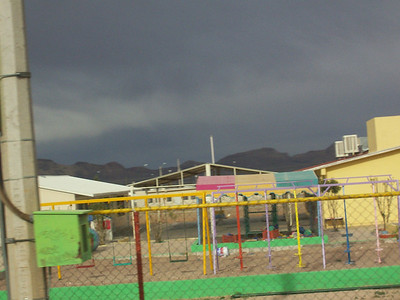 A park in the outskirts of the city. I love the bright colors against the dark sky. I think we were having a dust storm then. There were lots of dust storms.