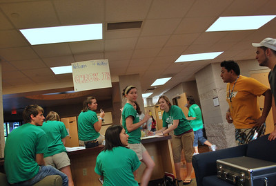 More students milling about in the lobby.