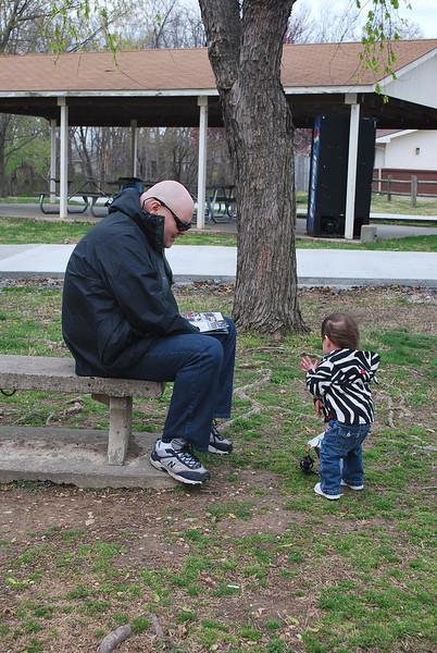 Talking to Papa at the park.