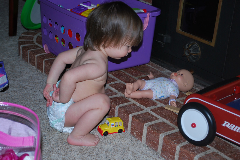Playing with her baby doll.