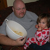 Sharing popcorn with Papa...this is a nightly ritual.