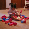 She concentrates so intensely when she is building with her Legos.