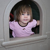 Peeking through the window.