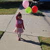 Leaving Lexi's party with a bunch of balloons!