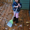 She loves to sweep the porch like Mama.