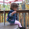 Playing on her little table on the deck.