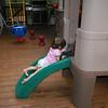 Down the slide.