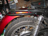 Place the rack in position with the shock mounting bolt washer between the rack and the shock