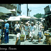 A street in Kaohsiung, Taiwan lined with shops and full of shoppers.  September 1954.