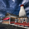 """Got Milk?""<br /> New Bedford, MA<br /> <br /> The New Bedford Bottle is 52' tall and was built in 1930. It was erected by Frates Dairy along with one in Raynham. The property has changed hands and is now a Pizza restaurant.<br /> <br /> Now is G+S Pizza<br />  <a href=""http://www.gspizzanewbedford.com/"">http://www.gspizzanewbedford.com/</a>"