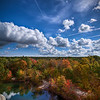 """""""Cumulus Clouds & Chemtrails over New England Foliage""""<br /> October 14th, 2010<br /> <br /> On top of The Assonet Ledge<br /> Freetown State Forest, MA"""