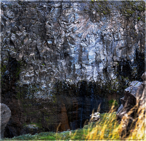 The rock wall on one side of the river flowing away from the Gullfoss waterfall in Iceland.