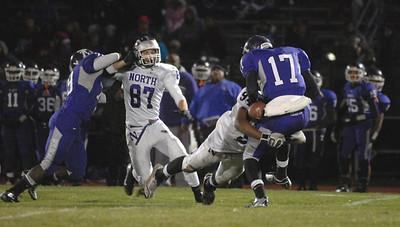 Downers Grove North junior defensive lineman Joseph Hill (94) sacks Thornton's quarterback during a second-round playoff game at Thornton on Friday, Nov. 2, 2012. Staff photo by Matthew Piechalak