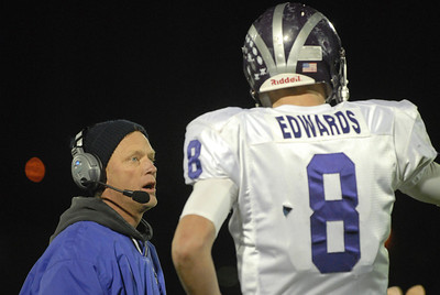 Downers Grove North head coach John Wander talks to sophmore quarterback David Edwards on the sideline during a second-round playoff game at Thornton on Friday, Nov. 2, 2012. Staff photo by Matthew Piechalak