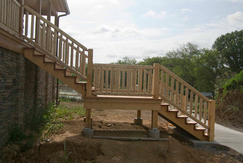 Stairs at front of building.