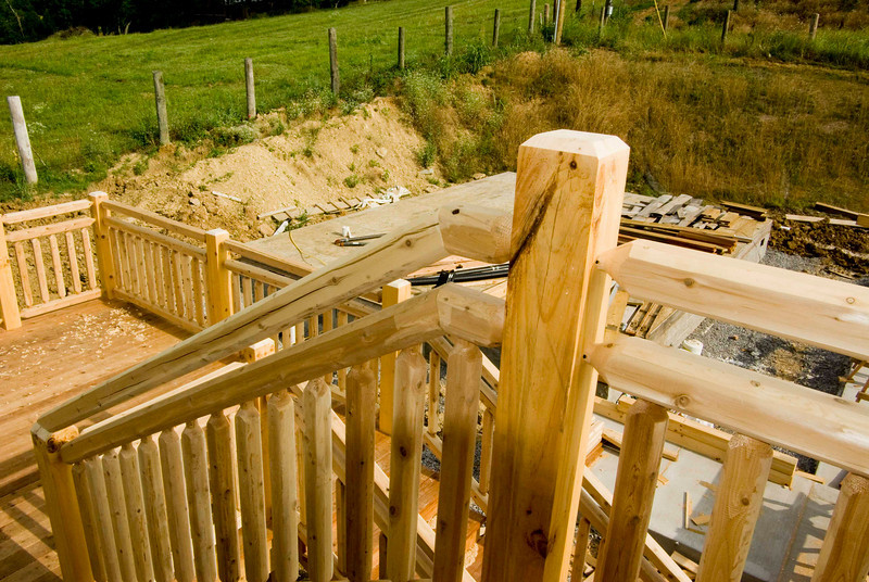 Guardrail on stairs from balcony to deck.
