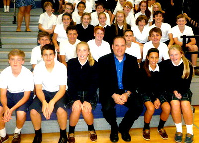 Detective Richard Wistocki (center), a member of the U.S. Secret Service Computer Crimes Task Force, talked to 5th, 6th, 7th, and 8th grade students at Immaculate Conception Grade School in Elmhurst on September 10th about the dangers of cyber predators and how to avoid being a victim.  Photographer's Name: Kathleen Hillsman Photographer's City and State: Elmhurst, IL