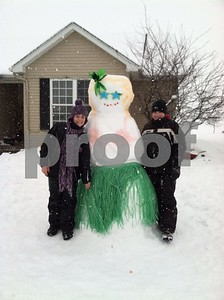 Jake and Jenny Linden try to bring warmth to Maple Park on their snow day.   Photographer's Name: Monica Linden Photographer's City and State: Maple Park, IL