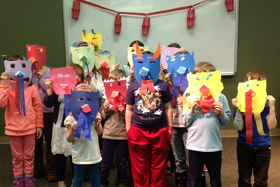 "K-5 students had a great time making dragon masks to celebrate the Chinese New Year at the Lisle Library on February 9, 2015.  For more upcoming ""Monday Funday"" Lisle Library programs, visit lislelibrary.org.  Photographer's Name: Nicole Mueller Photographer's City and State: Lisle, IL"