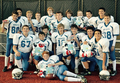 "To commemorate Immaculate Conception Grade School's first night football game under the lights at Plunkett Athletic Complex in Elmhurst, the ICGS football program collected night-time donations for the Immaculate Conception Parish Food Pantry, DuPage P.A.D.S., and Catholic Charities.  Donations came from Junior Varsity and Varsity football players, parents, and friends.  Pictured are eighth grade varsity football players who promoted ICGS' ""Knight Night Bedtime Drive"" on October 3rd.  Photographer's Name: Kathleen Hillsman Photographer's City and State: Elmhurst, IL"