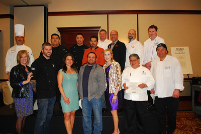 At the third Taste Takes Flight event, more than $65,000 was raised to benefit WINGS' (Women in Need Growing Stronger) Safe House and other services provided to women and children who are victims of domestic violence. Front Row, from the left:Front Row, from the left: Front Row, from the left:Sue Rogers, Event Co-Chair, Chef/Owner Jeramie Campana (Wild Asparagus), Ambassador Michele Butera (Butera's Market), Chef/Owner Gaetano Nardulli ( NEAR), Nina Stephenson, Event Co-Chair, Executive Chef Tino Almarez (The Rosewood Restaurant and Banquets), Executive Chef Walter Luppo (Makray Memorial Golf Club).Top Row, from the left: Executive Chef Massimo Salatino (Francesca's), Executive Chef Juan Luis Gonzalez (Mago's Grill & Cantina), Executive Chef Jose Castillo (L'Eiffel Bistrot & Creperie), Executive Chef Francisco Trejo ( Chessie's), Executive Chef Theodore Stay ( McGonigal's Pub and The Annex), Celebrity Chef Jamie Laurita, Executive Chef Dino Simon (Wynstone Golf Club), Chef de Cuisine Cameron Grant (Fresco 21).  Photographer's Name: Suzanne Poggio Photographer's City and State: Lake Barrington, IL