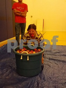 Lisa Steinbis bobbing for apples at the Opportunity House 3rd Annual Fall Festival and Chili Cook-off  Photographer's Name: Nicole Safford Photographer's City and State: Sycamore, IL