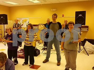 """Opportunity House clients performing with """"The Ukelele Moonshiners"""" at the 3rd Annual Fall Festival and Chili-off on October 4, 2014  Photographer's Name: Nicole Safford Photographer's City and State: Sycamore, IL"""
