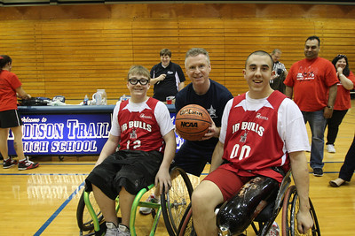 Jr. Bulls play in exhibition fund raising wheelchair basketball game with Addison Police Department members.  Photographer's Name: Bruce Flowers Photographer's City and State: Addison, IL