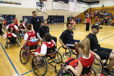 Officers from Addison Police Department greet the NEDSRA Jr. Bulls before the exhibition game at Addison Trail High School.   Photographer's Name: Bruce Flowers Photographer's City and State: Addison, IL