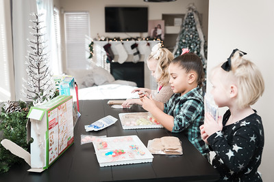 """We attempted to build gingerbread houses. I use the word """"attempted"""" purposefully. Even though we used kits, this building business did not go as smooth as the box would have you believe."""