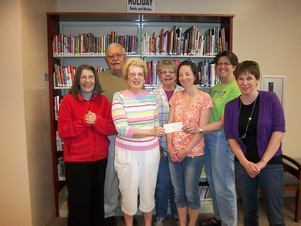"The Friends of the Town and Country Public Library group donated $3,200 to the library for its summer reading program, which begins June 4 and runs through Aug. 4. The money was raised from the group's annual plant sale and spring garden raffle. Joan Hansen, executive vice president of the group, is shown presenting the check to Cathy Korthals, adult services librarian. Other Friends members include (from left), Ivanka Grabarek, Bill Grabarek, Marilyn Stamp, Tania Miller and Karen Flamand, technical services librarian. The Friends group is a 501c3, nonprofit volunteer-driven organization. Learn more at  <a href=""http://www.elburnfriends.org"">http://www.elburnfriends.org</a>.<br /> <br /> Photographer's Name: Provided photo"