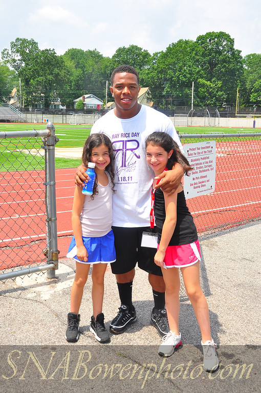 Baltimore Ravens RB Ray Rice at the annual Ray Rice day. June 18, 2011<br /> Location: New Rochelle High School<br /> Hugging fans