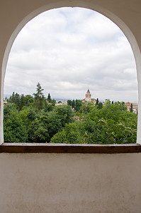 Another scenic view, framed by a window in Alhambra.