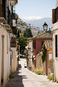 Heading up the hill in the old quarter, you see the snow-capped mountains.