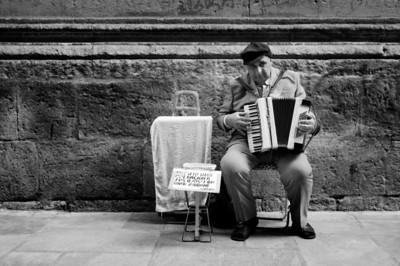 Local musician on a back street near the Cathedral.