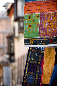 Brilliant colors are everywhere.These fabrics were hanging outside a small shop.