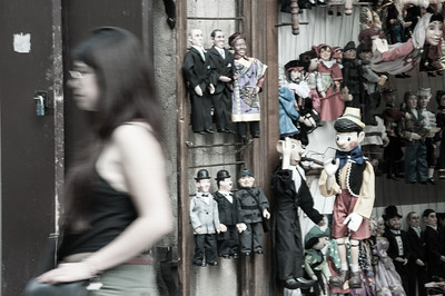 Pinocchio waves sadly as the girl of his dreams passes by.