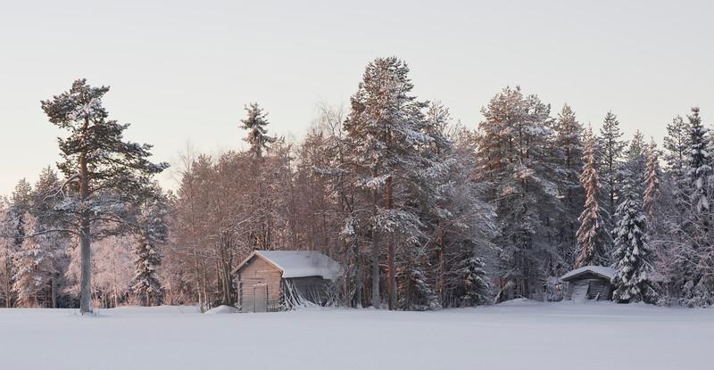 Wooden sheds in a field outside Ruka