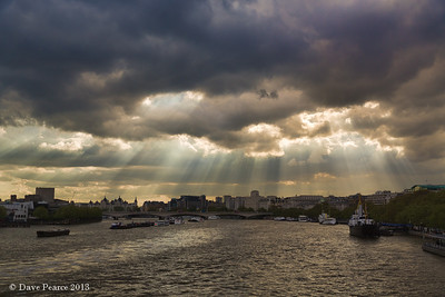 Breaking through the clouds over the Thames.