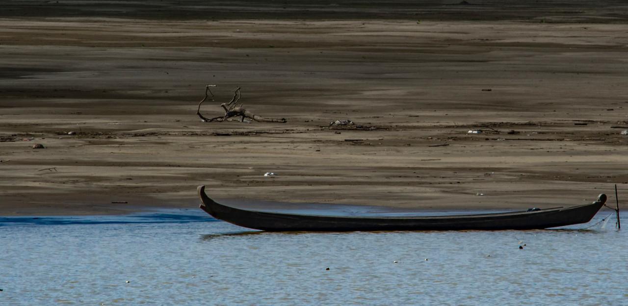 Dugout canoe on sandbar